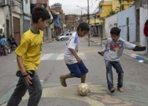 Boys playing football in the streets of Brazil